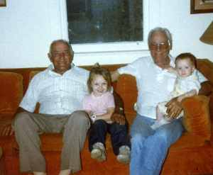 File3010 Two Grandpas and two granddaughters. My Dad David sitting next to our oldest daughter Sheila, my Father-in-law Carlton holding our youngest baby Taylor.
