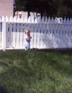 When we moved to Pasadena, James and David built a white picket fence and James and Carlton planted a bluegrass lawn for the children to play on. Here's Taylor.