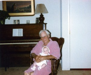 Grandpa Carlton in the rocker holding baby Taylor.